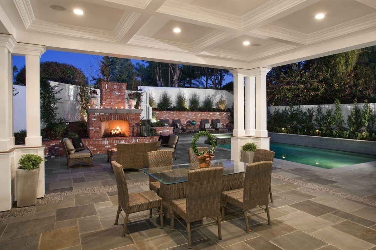 Downlight Bronze Outdoor Lighting Fixtures In A Paved Patio – Artenzo Inside Most Popular Outdoor Ceiling Lights For Patio (View 4 of 20)
