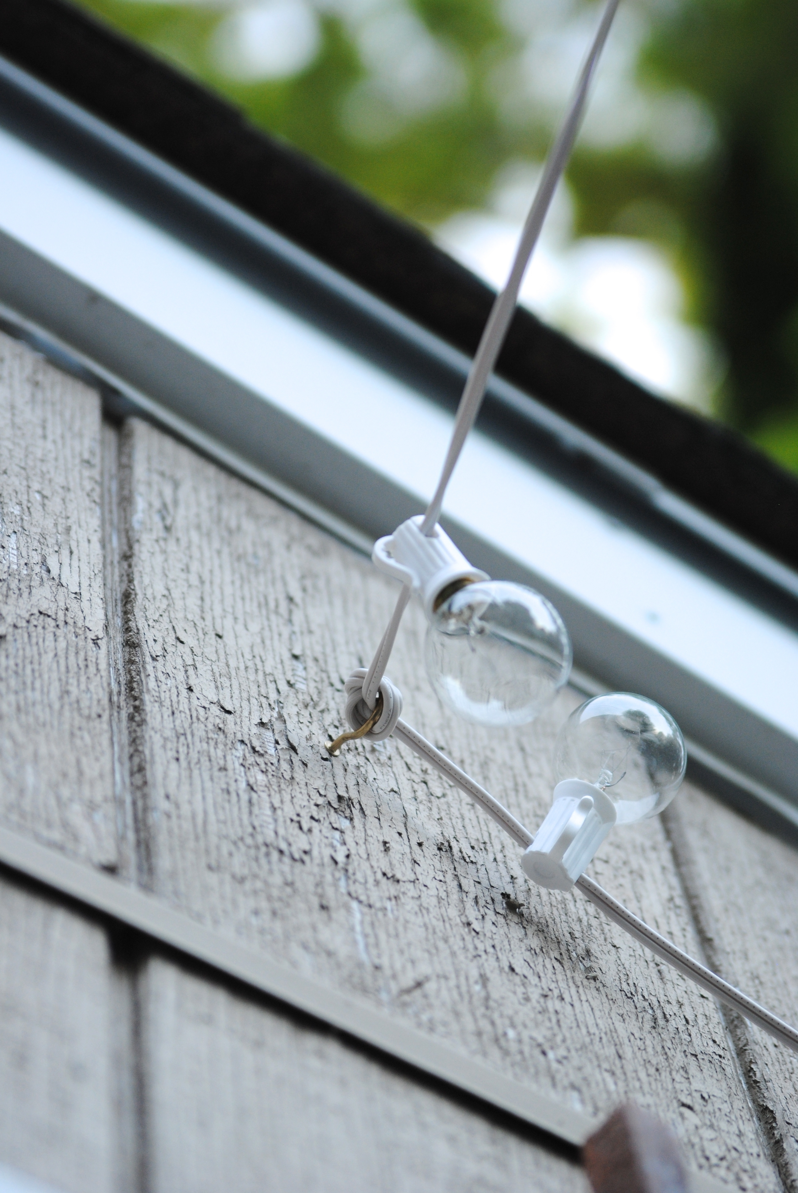 Fashionable Hanging Outdoor Lights On Stucco For How To Hang Outdoor String Lights (The Deck Diaries, Part  (View 10 of 20)