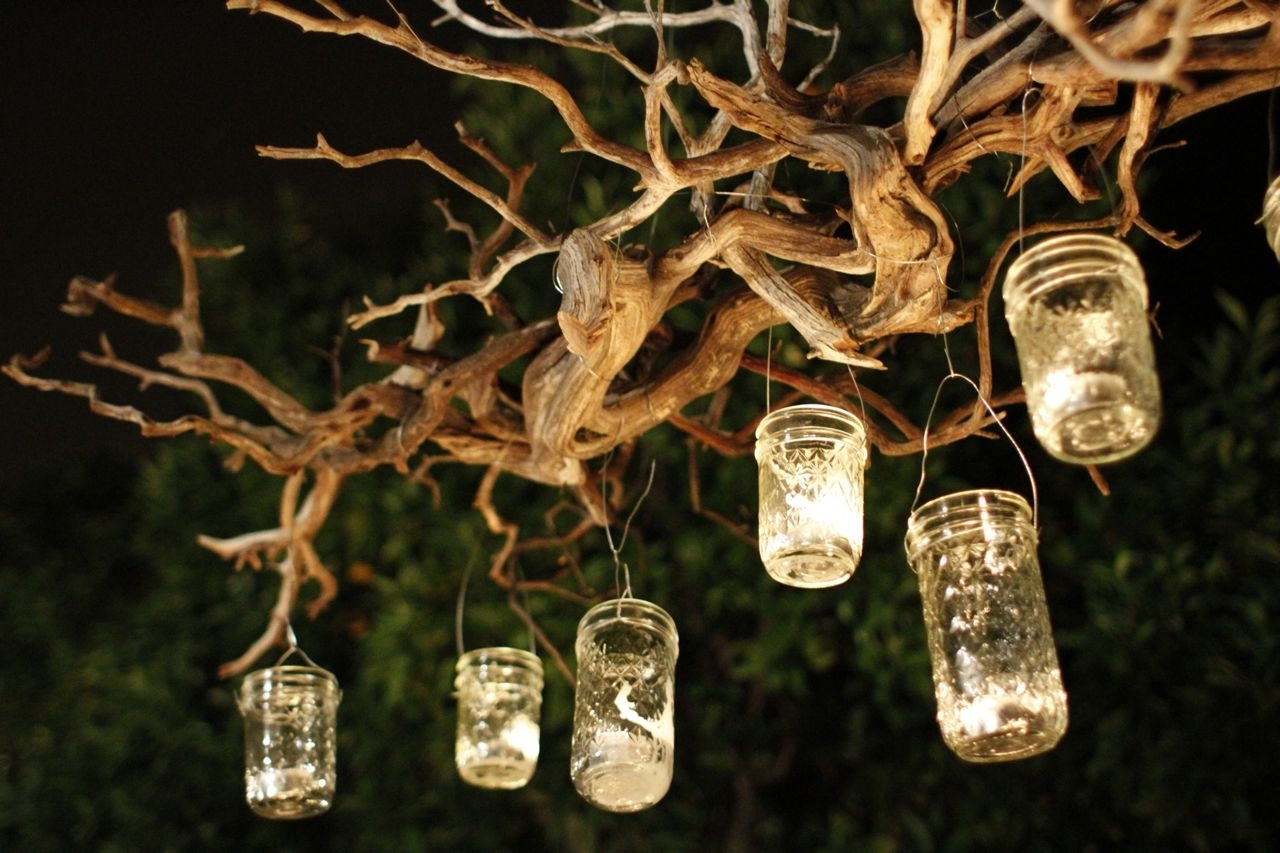 Favorite Capture The Light With A Diy Outdoor Mason Jar Chandelier With Hanging Lights On An Outdoor Tree (View 7 of 20)