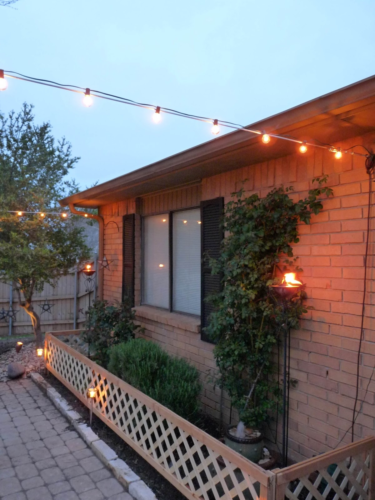 Hanging Outdoor Lights On Fence In Newest The Happy Homebodies: Diy: Stringing Patio Cafe Lights (View 19 of 20)