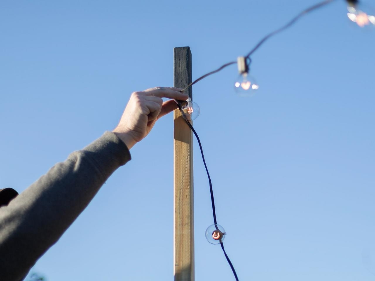 Hanging Outdoor Lights On Wire Within Fashionable How To Hang Outdoor String Lights From Diy Posts (View 20 of 20)