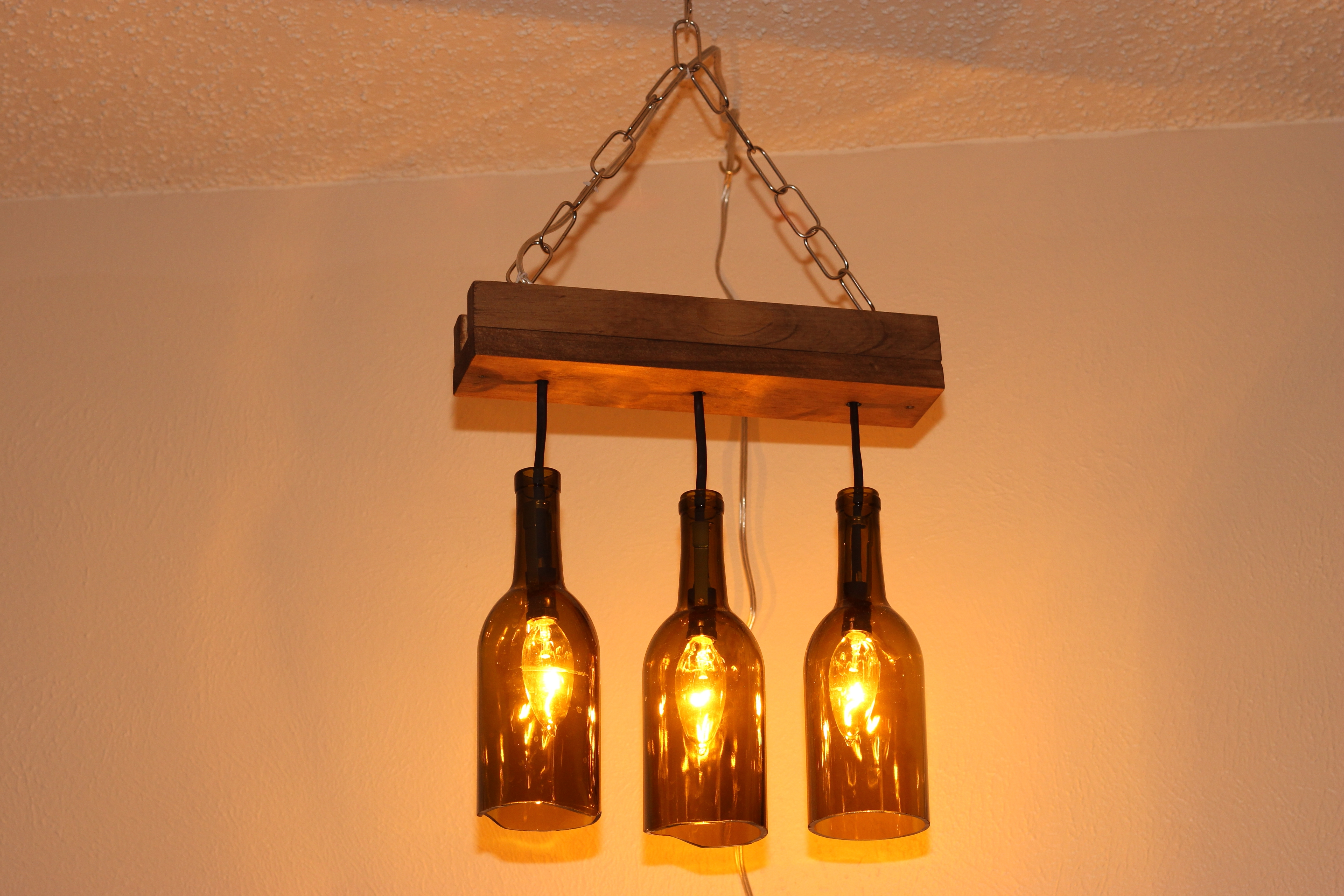 Making Outdoor Hanging Lights From Wine Bottles With Regard To Latest Wine Bottle (View 18 of 20)