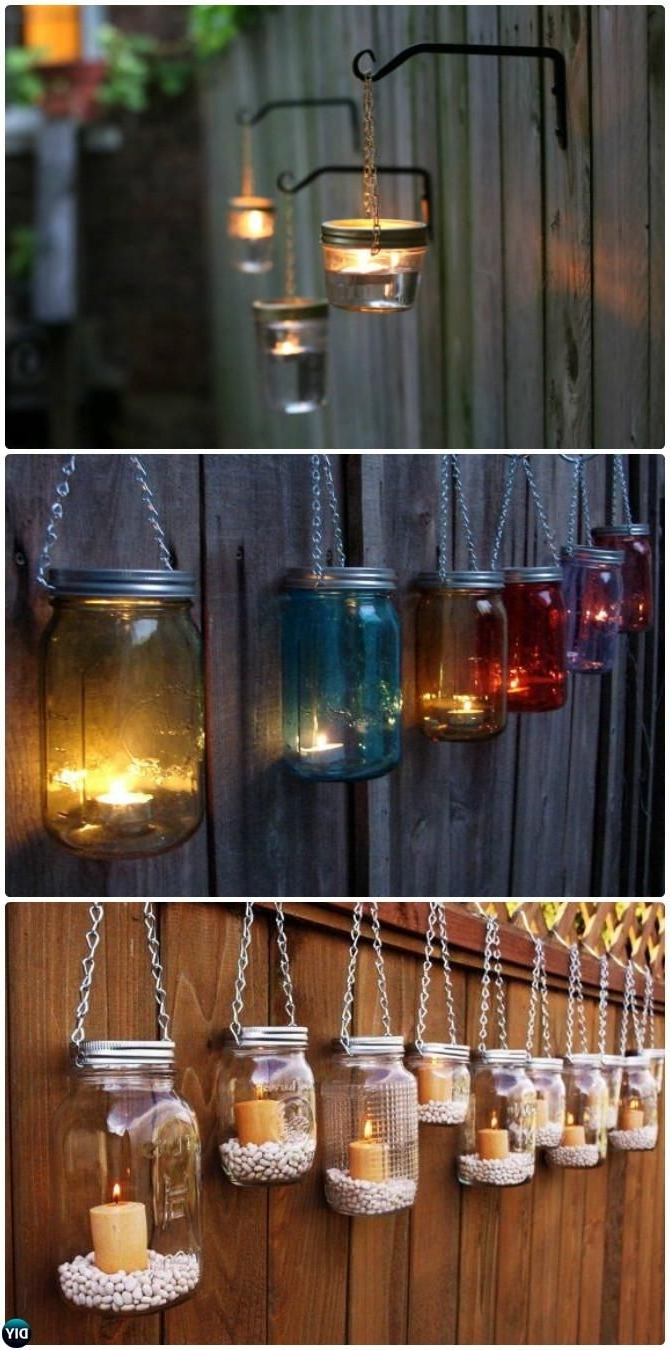 Most Up To Date Outdoor Hanging Mason Jar Lights With Regard To Diy Hanging Mason Jar Lights #garden Fence #decor Instructions  (View 10 of 20)