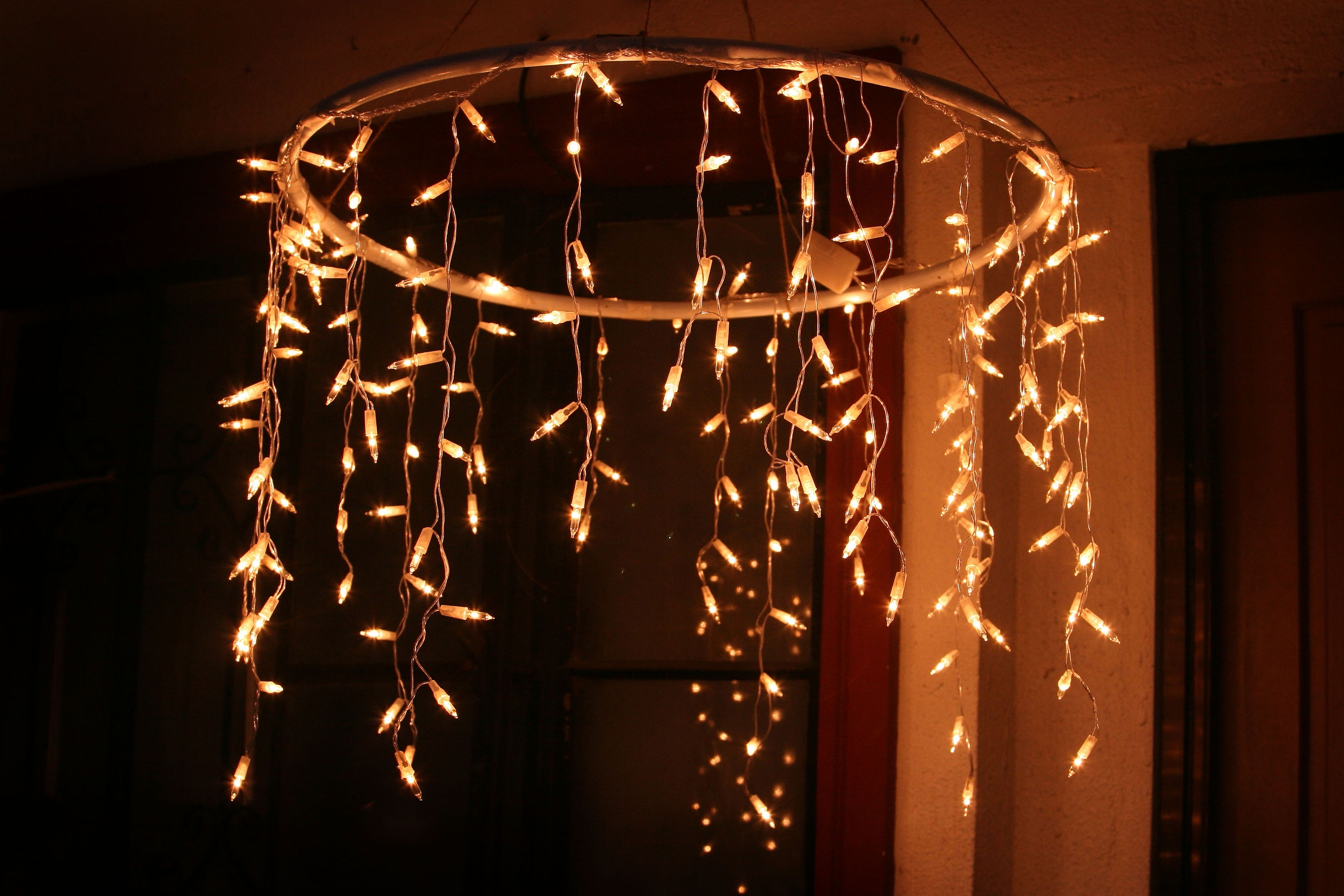 Most Up To Date Outdoor Hanging Xmas Lights Pertaining To How To Make An Outdoor Chandelier With Icicle Christmas Lights (View 9 of 20)