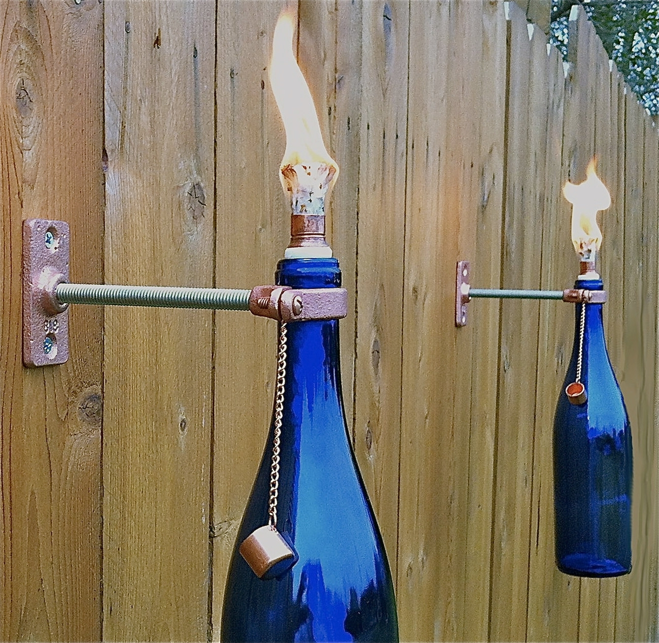 Outdoor Hanging Bottle Lights Within Widely Used Cobalt Blue Wine Bottle Tiki Torches Will Add Stylish Lighting To (View 14 of 20)