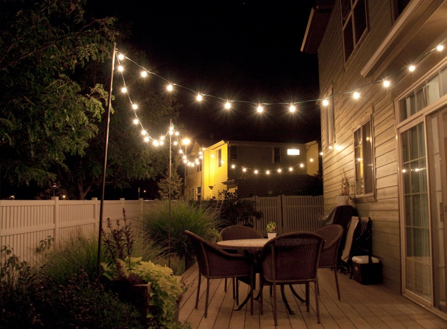 Outdoor Hanging String Lanterns Pertaining To Recent How To Make Inexpensive Poles To Hang String Lights On – Café Style (View 2 of 20)