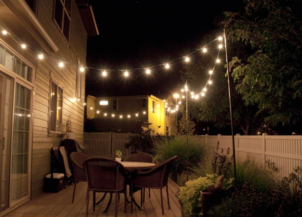 Outdoor String And Patio Lights With Favorite Outdoor And Patio: Simple Outdoor String Lighting With Wicker Dining (View 13 of 20)