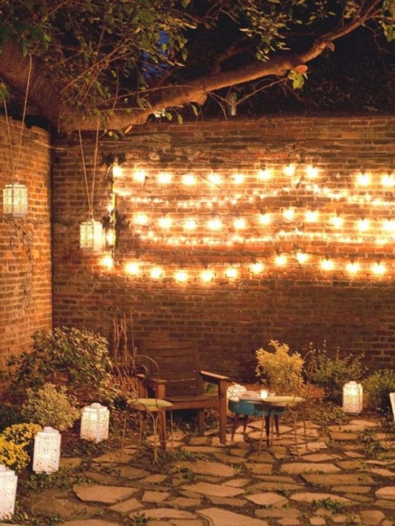 Popular Hanging Outdoor Lights On Brick Intended For Brick Wall Design With Enticing String Lights And Stone Floor For (View 16 of 20)