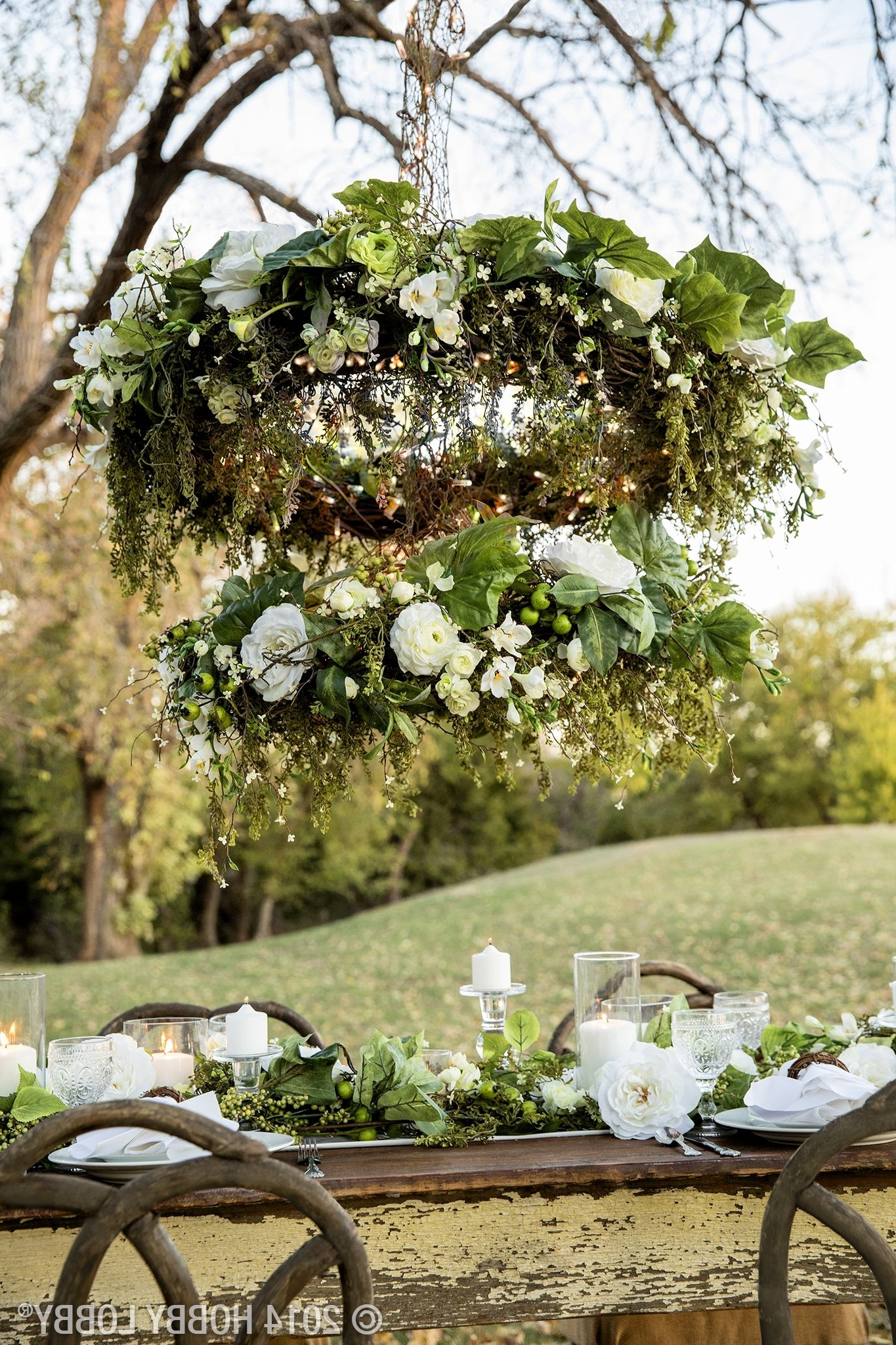 This Two Tiered Diy Chandelier Is Made From Grapevine Wreaths, White Throughout Famous Outdoor Hanging Grape Lights (View 16 of 20)