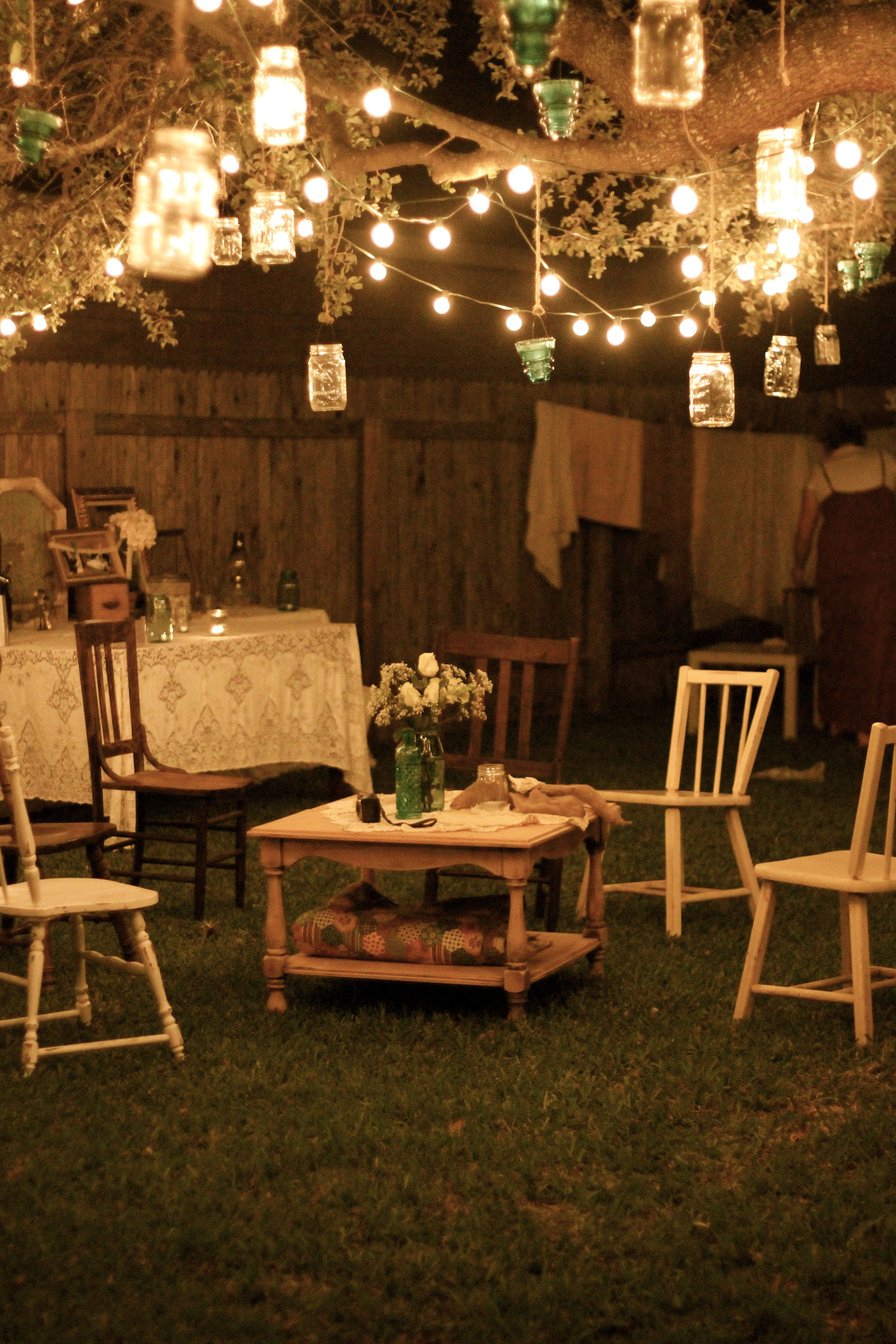 Well Known Garden Party At Night; Lanterns Hang From Tree Branches, And Rustic Intended For Hanging Lights For Outdoor Wedding (View 18 of 20)