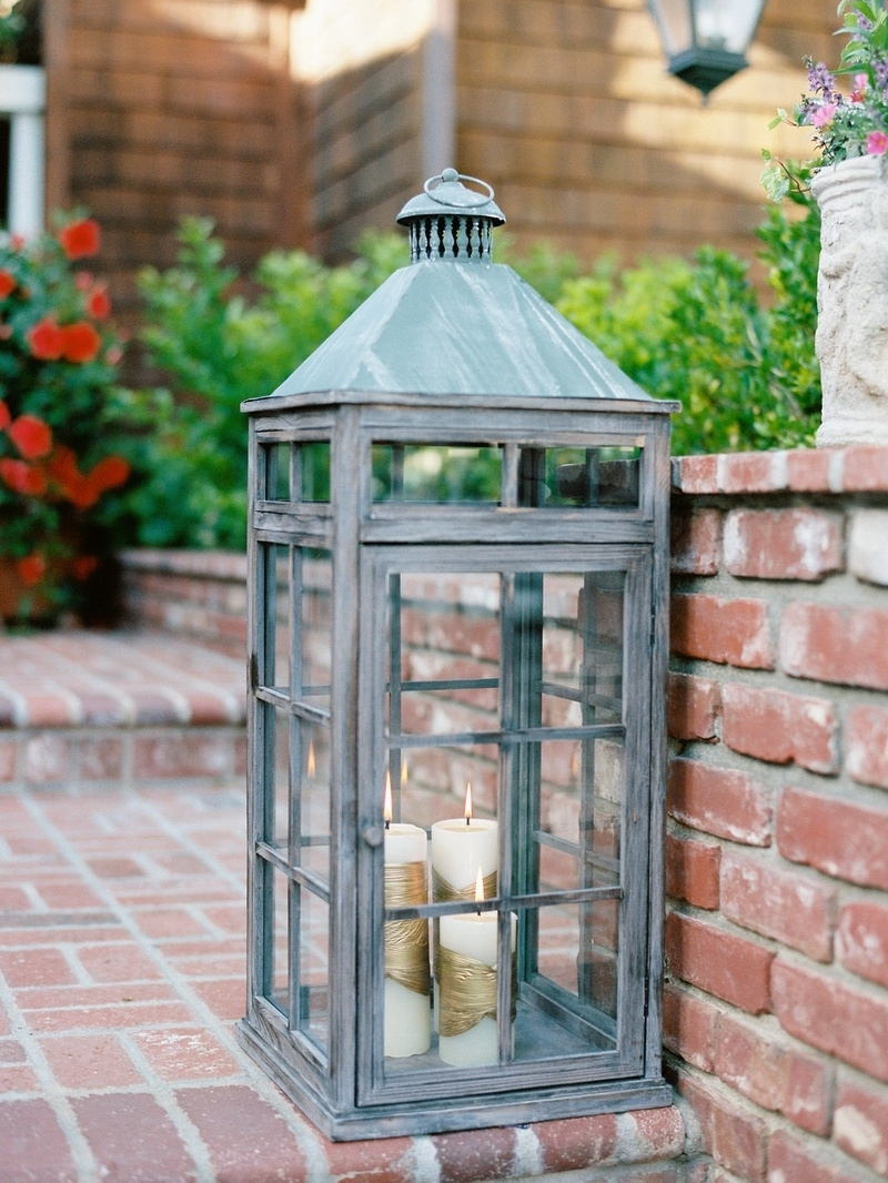 2019 Large Outdoor Rustic Lanterns Within Reception Décor Photos – Rustic Lantern With White & Gold Candles (Gallery 3 of 20)