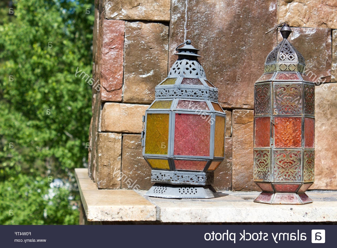 Colorful Outdoor Lanterns Pertaining To Well Known Antique Looking Metal Lanterns With Colorful Stained Glass Panels (Gallery 20 of 20)