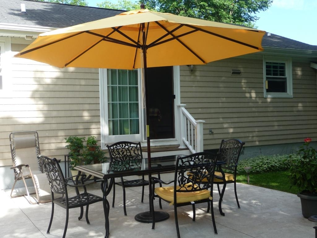 Contemporary Patio Ideas With Dark Brown Painted Wooden Yellow With Most Up To Date Yellow Sunbrella Patio Umbrellas (Gallery 10 of 20)
