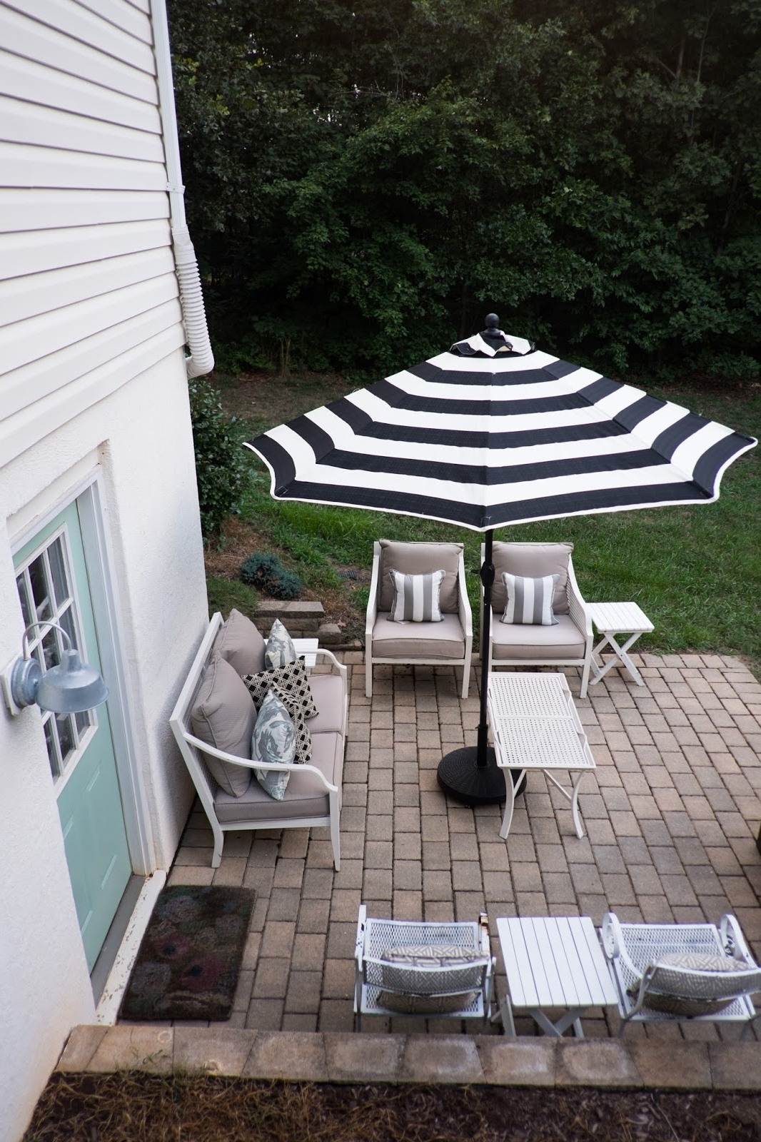 Domestic Fashionista: Backyard Patio Umbrellas Pertaining To Latest Black And White Striped Patio Umbrellas (View 8 of 20)