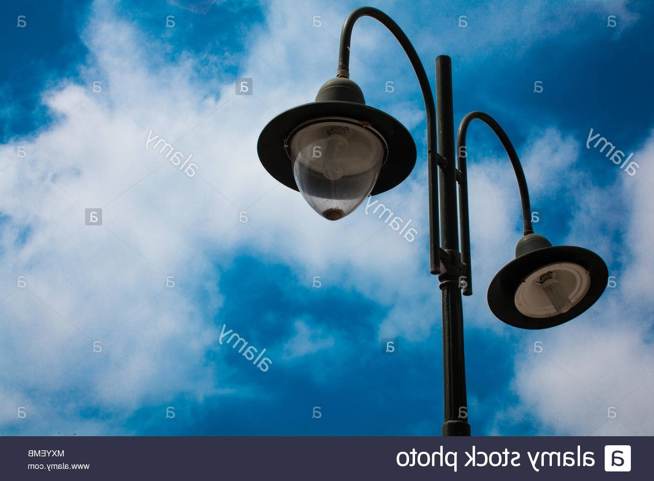 Fashionable Light Post With Two Bulbs And Blue Cloudy Sky Background. Outdoor Throughout Outdoor Cast Iron Lanterns (Gallery 14 of 20)