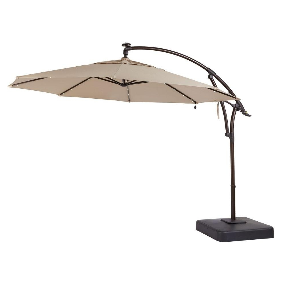 Hampton Bay 11 Ft. Led Offset Patio Umbrella In Sunbrella Sand Regarding Newest Extended Patio Umbrellas (Gallery 3 of 20)