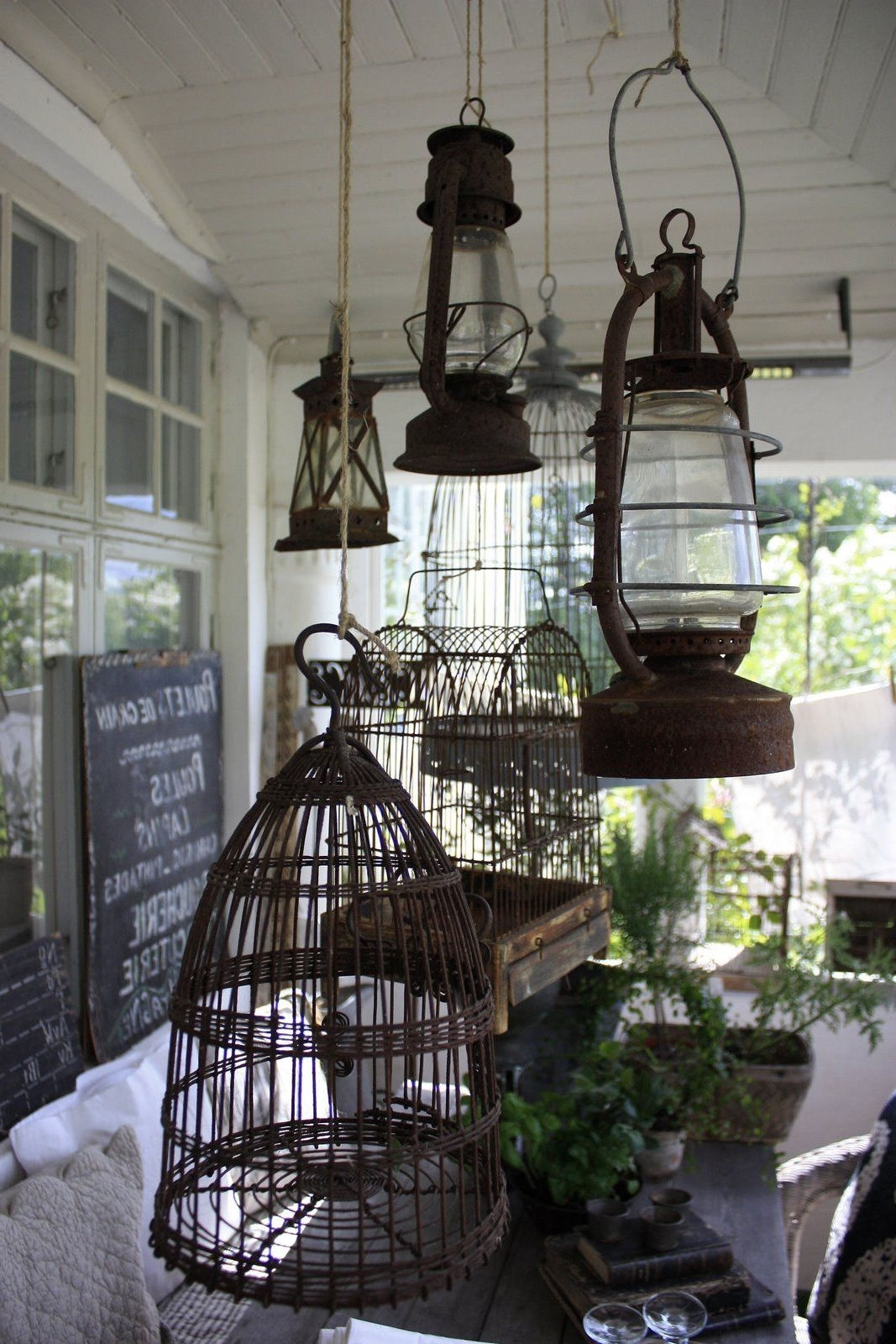 Hanging Bird Cages And Lanterns Above An Outdoor Table (View 5 of 20)