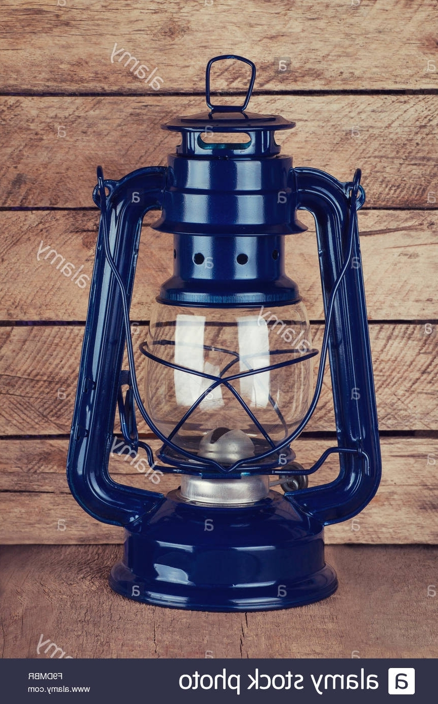 Most Up To Date Decorative Outdoor Kerosene Lanterns For Decorative Blue Kerosene Lamp On Wooden Table Stock Photo: (View 10 of 20)