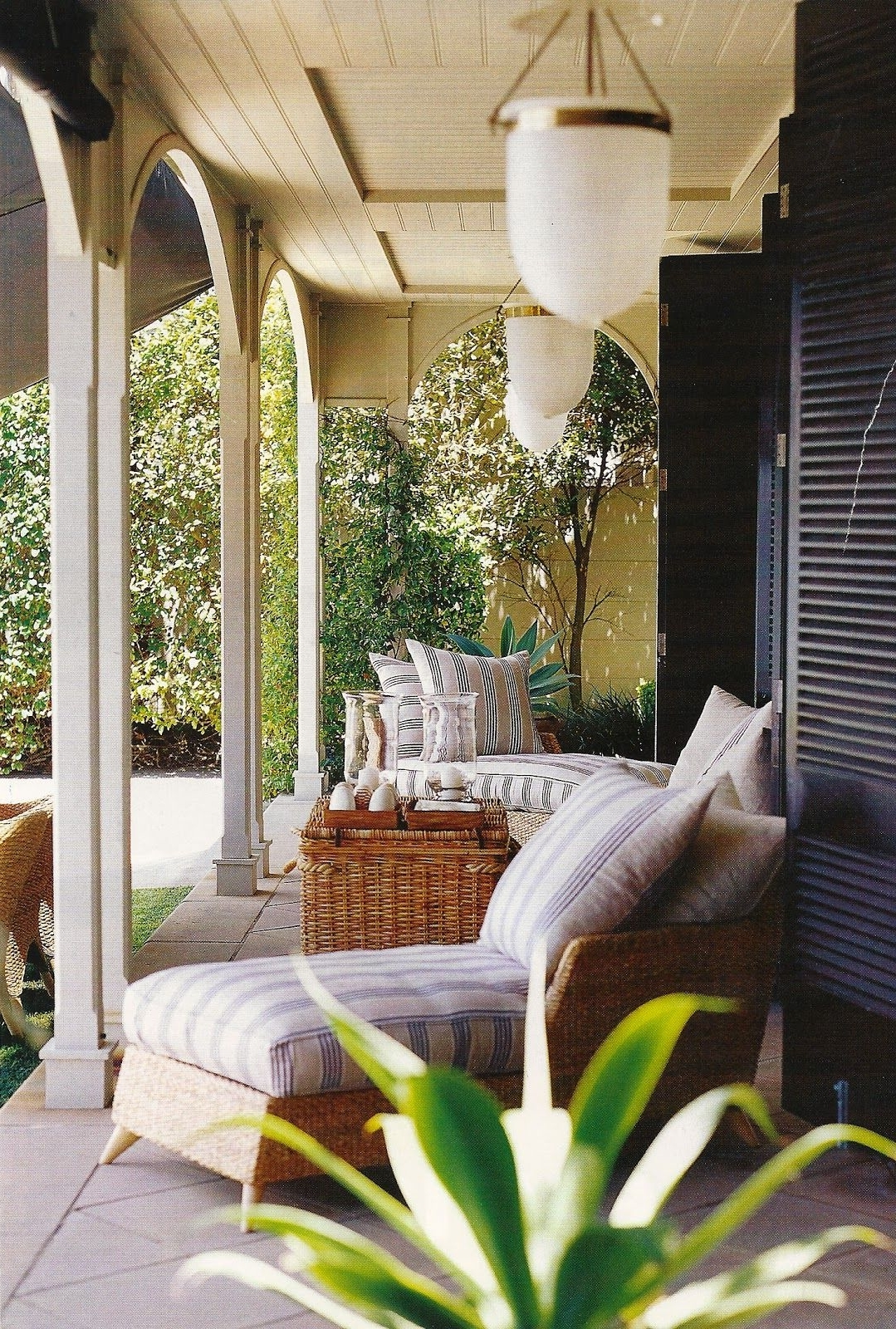 Most Up To Date Striped Chaise, Wicker Basket, Shells, Timber Veranda Detailing With Inside Outdoor Oversized Lanterns (View 10 of 20)
