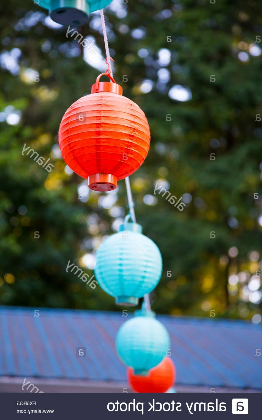 Newest Outdoor Paper Lanterns Regarding Red And Blue Paper Lanterns Hung Up High For An Outdoor Wedding (View 9 of 20)