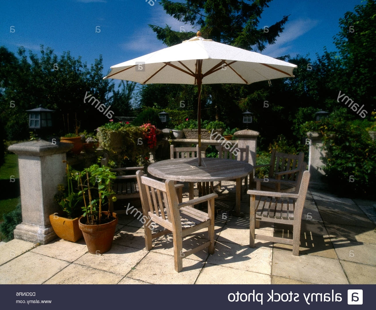 Newest Patio Table And Chairs With Umbrellas In Wooden Garden Furniture Table & Chairs & Sun Shade Umbrella Stock (View 17 of 20)