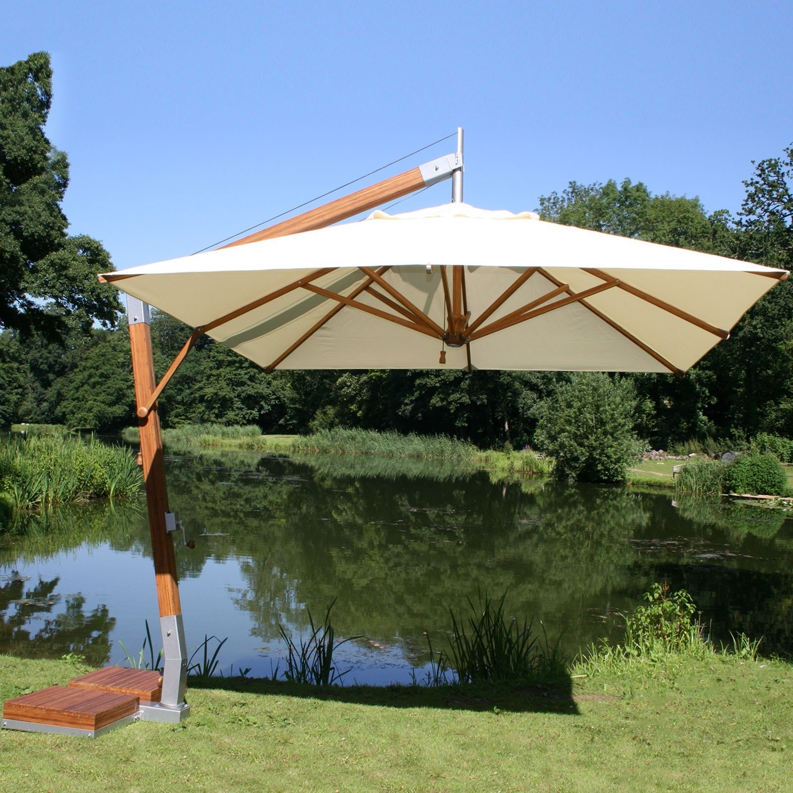 Offset Patio Umbrellas With Base In Most Recent Furniture: White Offset Patio Umbrellas With Bamboo At Hayneedle (View 11 of 20)