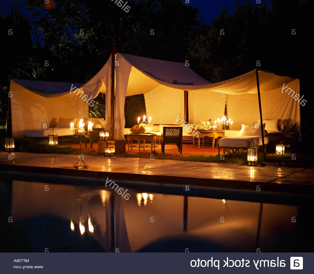 Outdoor Pool Lanterns Within Most Current Moroccan Hotel Outdoor Entertaining Lit Marquee At Nightpool (View 5 of 20)