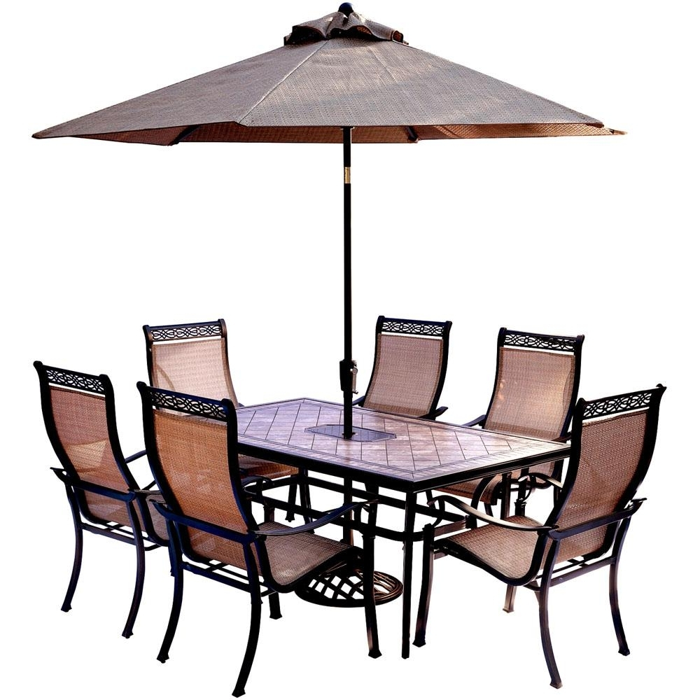 Popular Patio Table And Chairs With Umbrellas Within Hanover 7 Piece Outdoor Dining Set With Rectangular Tile Top Table (View 3 of 20)