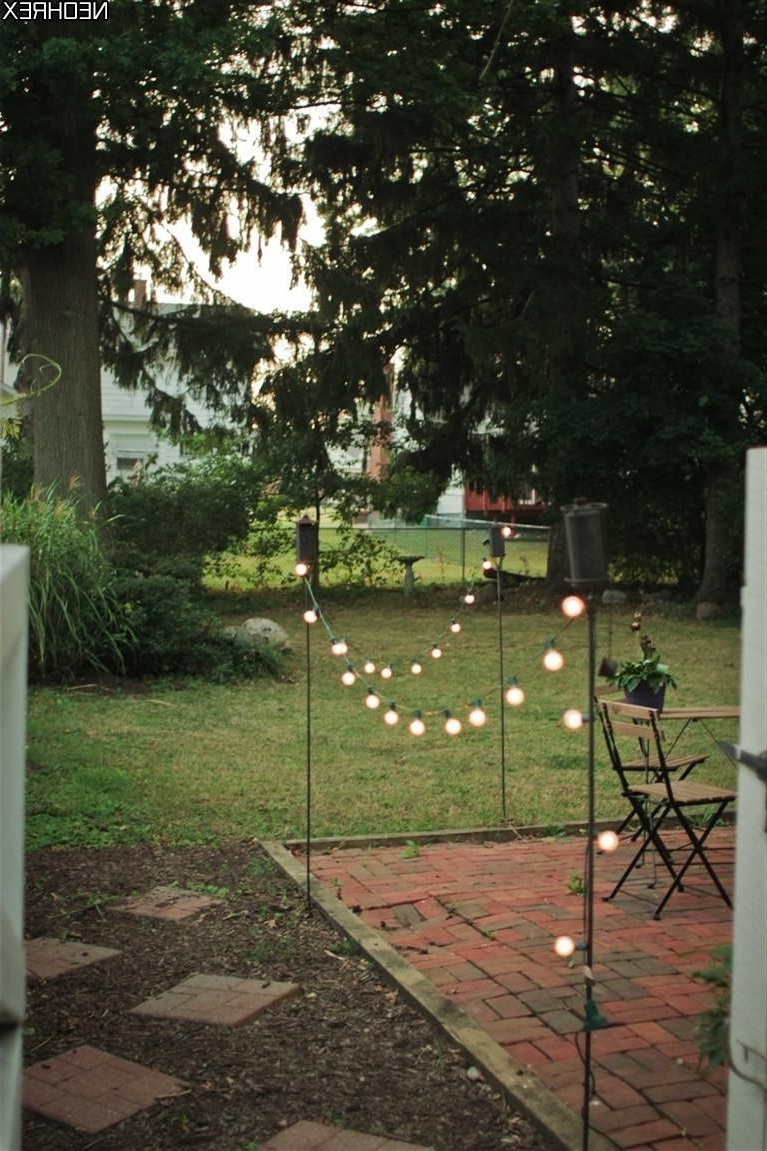 Popular Tiki Torches And Solar Lights Border Patio Area (View 18 of 20)