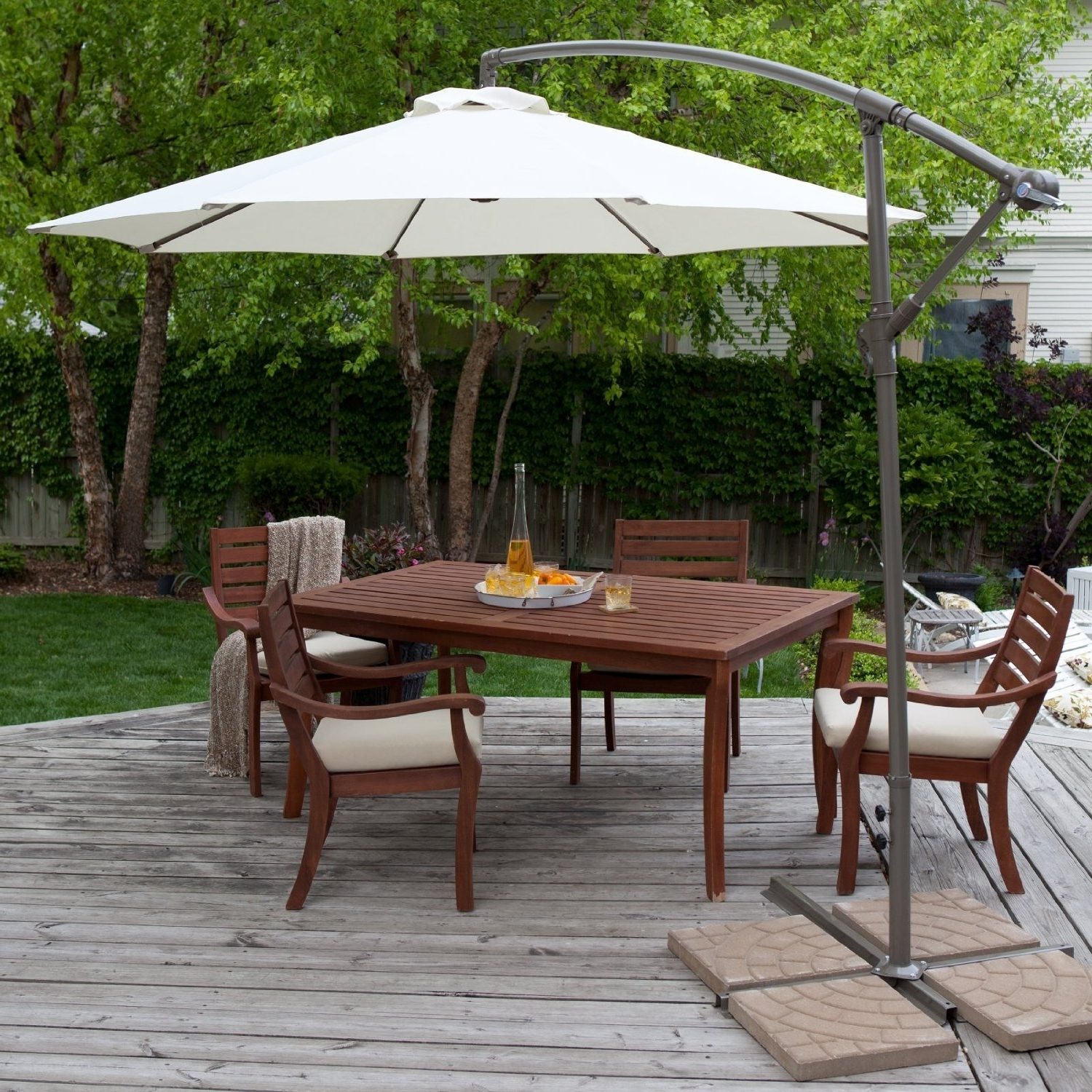 Recent Patio Umbrellas With Table With Round White Fabric Patio Umbrella With Black Base Over Dark Brown (View 18 of 20)