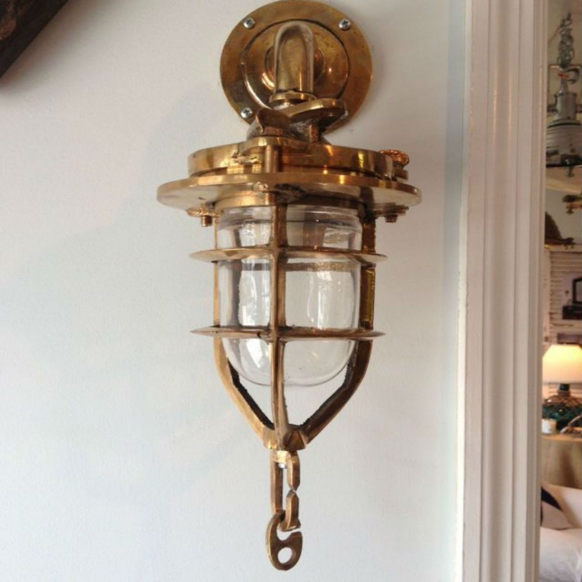 Trendy Outdoor Nautical Lanterns In Brass Convoy Sconce Light 2 Next To Mirror On Angled Wall Over Teak (View 19 of 20)