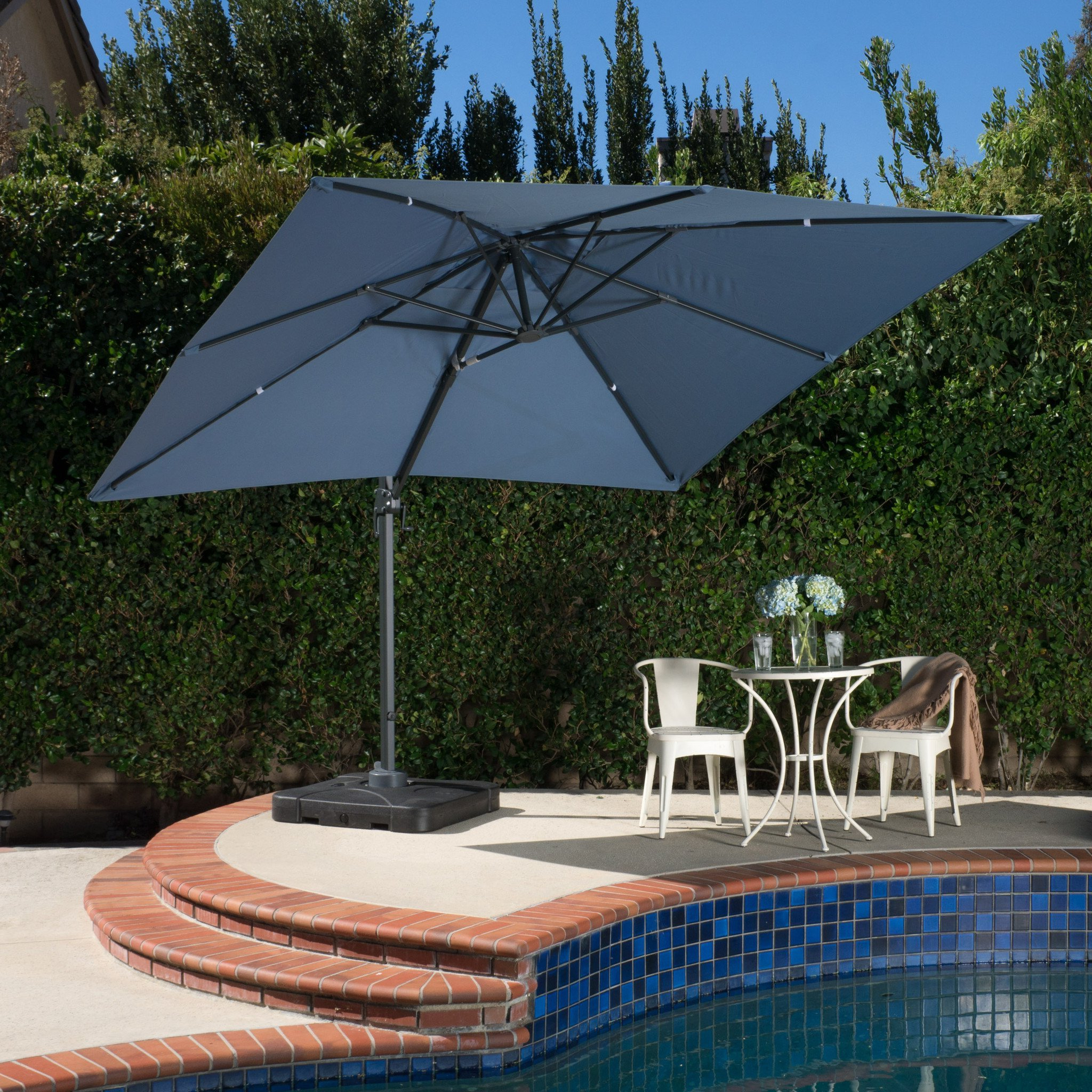 2019 Desmond Rectangular Cantilever Umbrellas Inside Denise Austin Home Sardinia Outdoor 9'8 Foot Canopy Umbrella With Stand (View 11 of 20)
