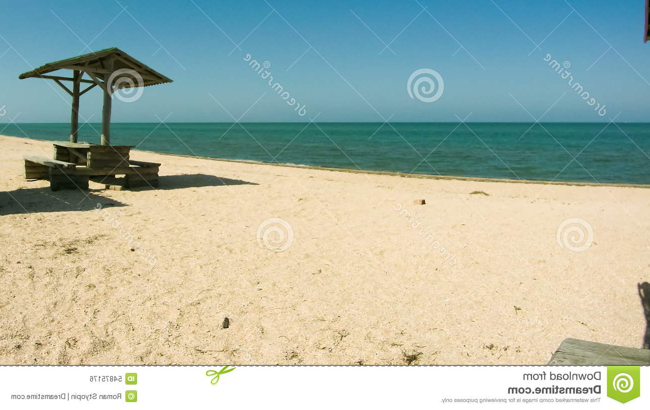 Auriville Beach Umbrellas Pertaining To Widely Used Beach Umbrellas And Wooden Tables And On The Beach Stock Footage (View 5 of 20)