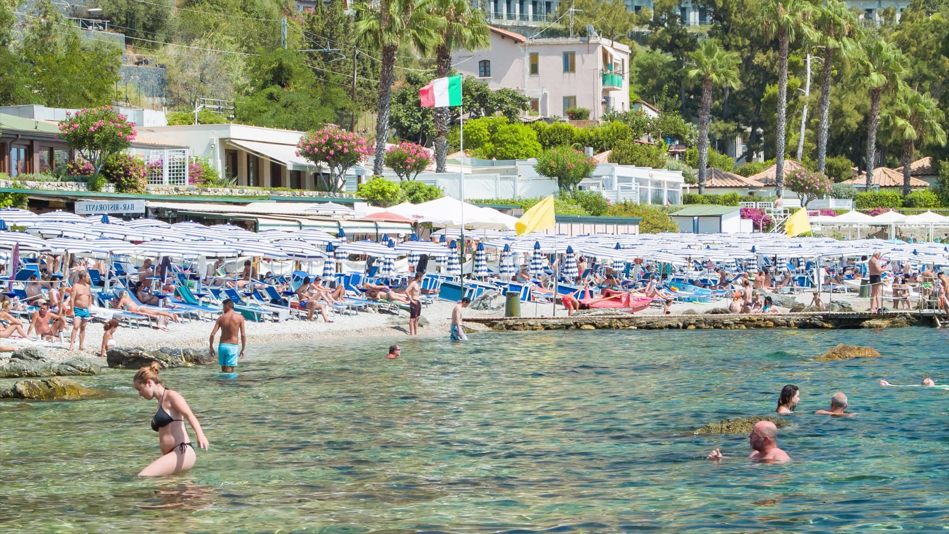 Bella Beach Umbrellas Inside Most Recently Released Taormina Sicily Popular Isola Bella Beachfront With Visitors Swimming And Enjoying Umbrellas And Chairs On The Famous Italian Resort Town Beach Stock (View 16 of 20)