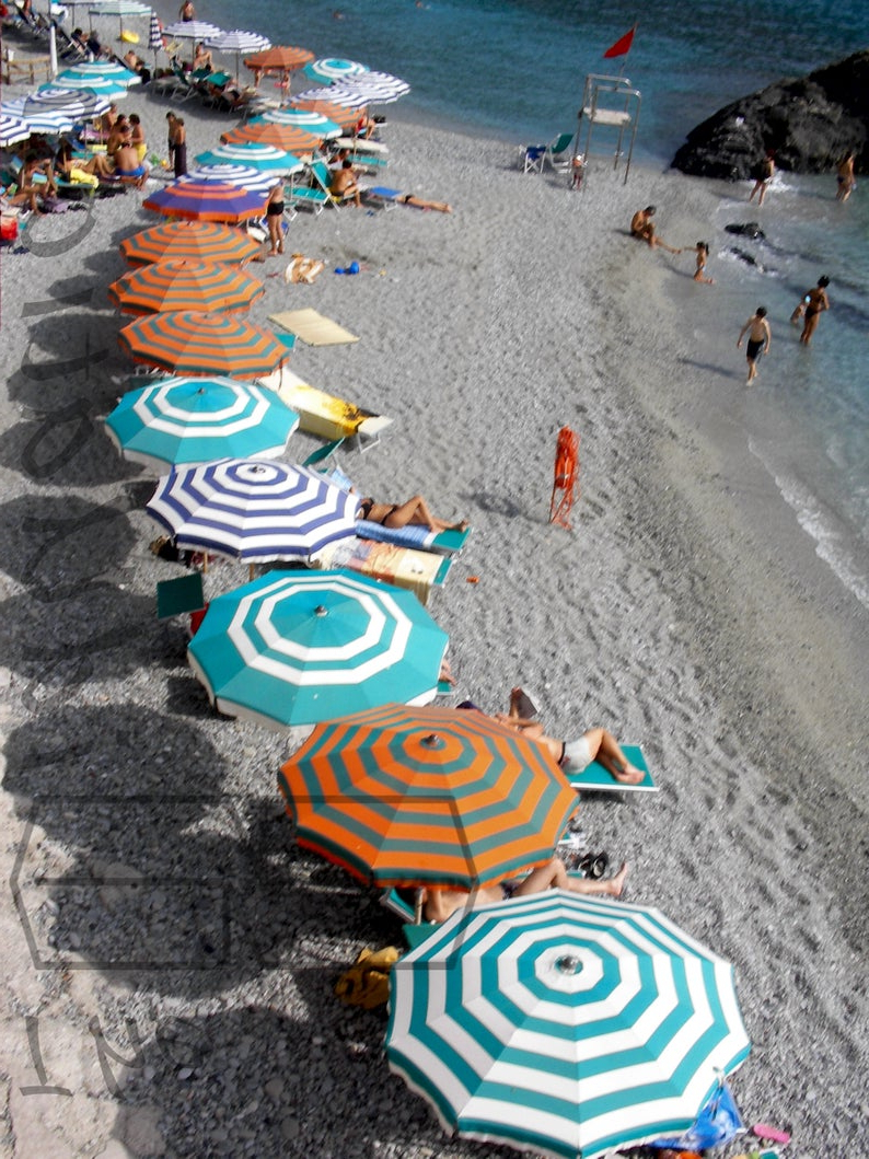 Featured Photo of Italian Beach Umbrellas