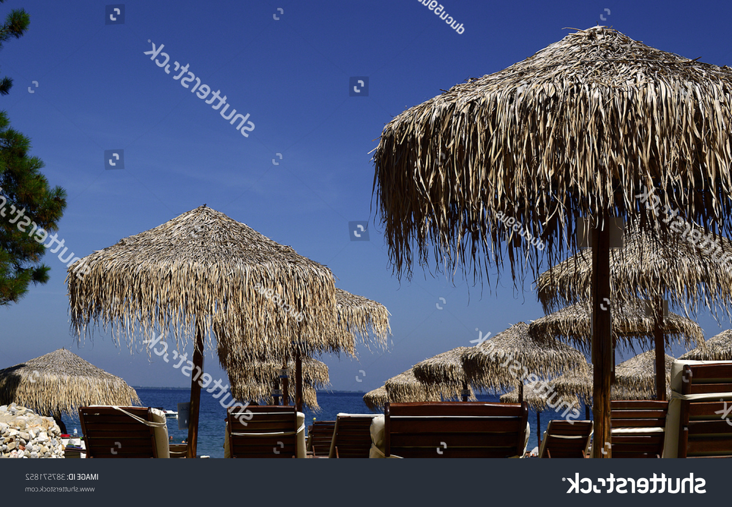 Current Seaside Beach Umbrellas Regarding Straw Umbrellas On Empty Seaside Beach Stock Photo (Edit Now (View 3 of 20)