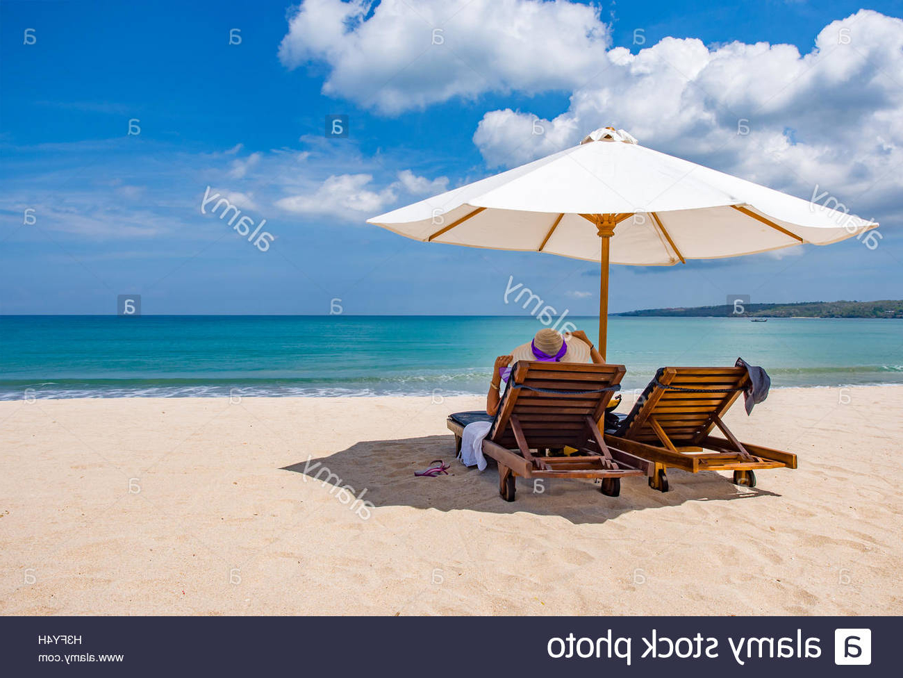 Current Woman Resting Under A Beach Umbrella Facing The Seaside In A With Regard To Seaside Beach Umbrellas (View 4 of 20)