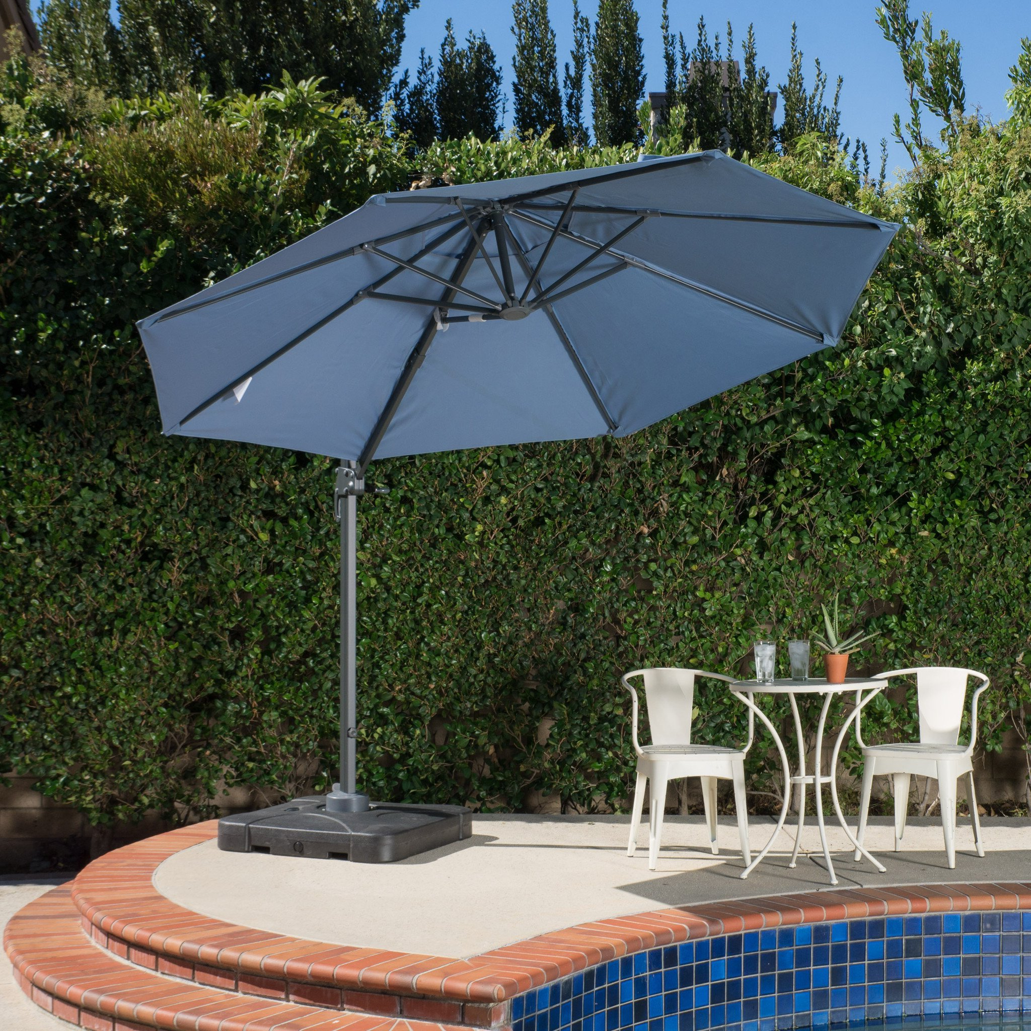 Denise Austin Home Bay Outdoor 9.8 Foot Blue Lavender Canopy Umbrella With Base Within Preferred Lennie Cantilever Sunbrella Umbrellas (Gallery 14 of 20)