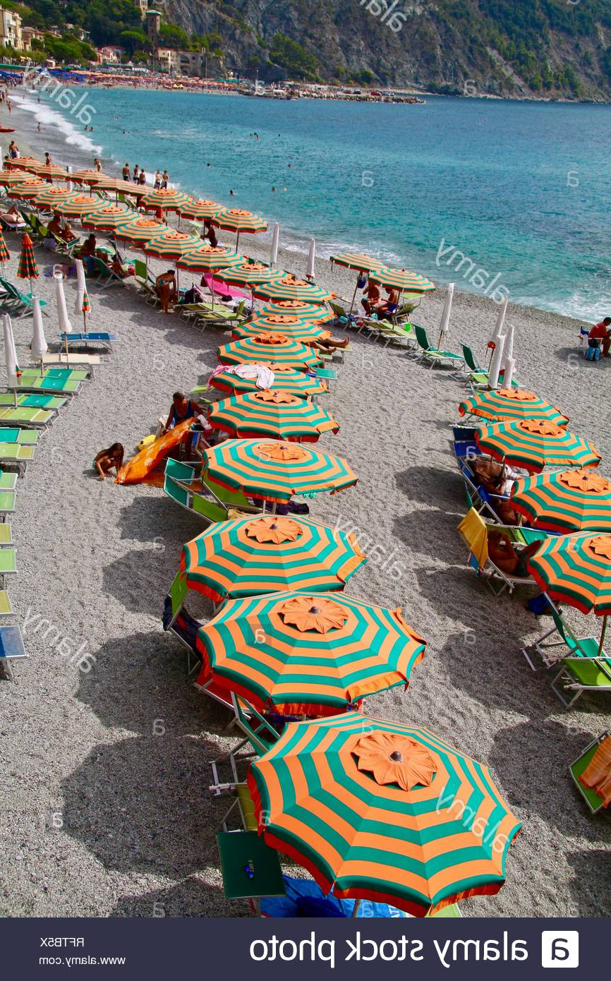 Italian Beach Umbrellas Inside Latest Orange And Green Striped Beach Umbrellas On A Popular Italian Beach (Gallery 5 of 20)