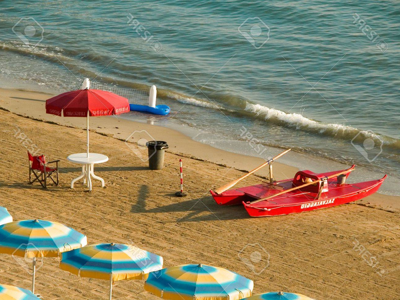 Italian Beach Umbrellas With Regard To 2020 Early Morning Seaside Scene With Umbrellas And Red Lifeguard. (View 14 of 20)