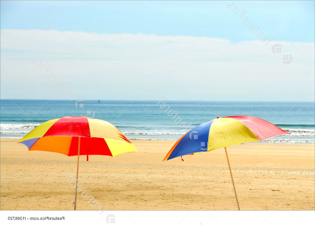Most Popular Beach Umbrellas Pertaining To Two Beach Umbrella Standing On Ocean Shore (View 7 of 20)