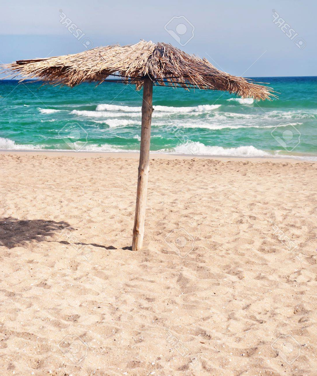 Most Popular Tropical Sea Beach With The Straw Beach Umbrellas With Beach Umbrellas (Gallery 8 of 20)