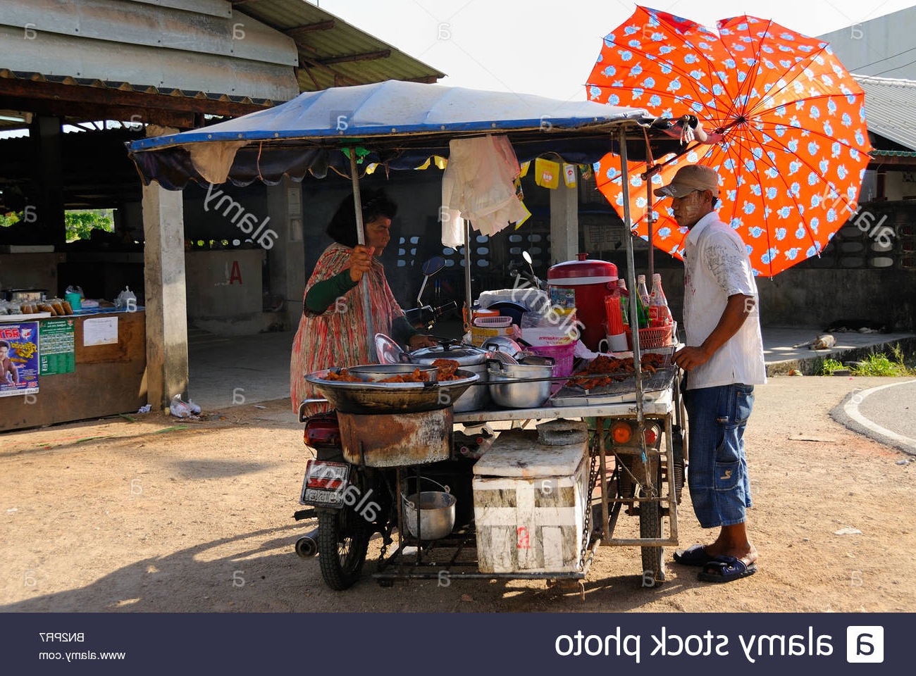 Selling Food Under Umbrella Stock Photos & Selling Food Under With Regard To Current Hawkinge Market Umbrellas (View 17 of 20)