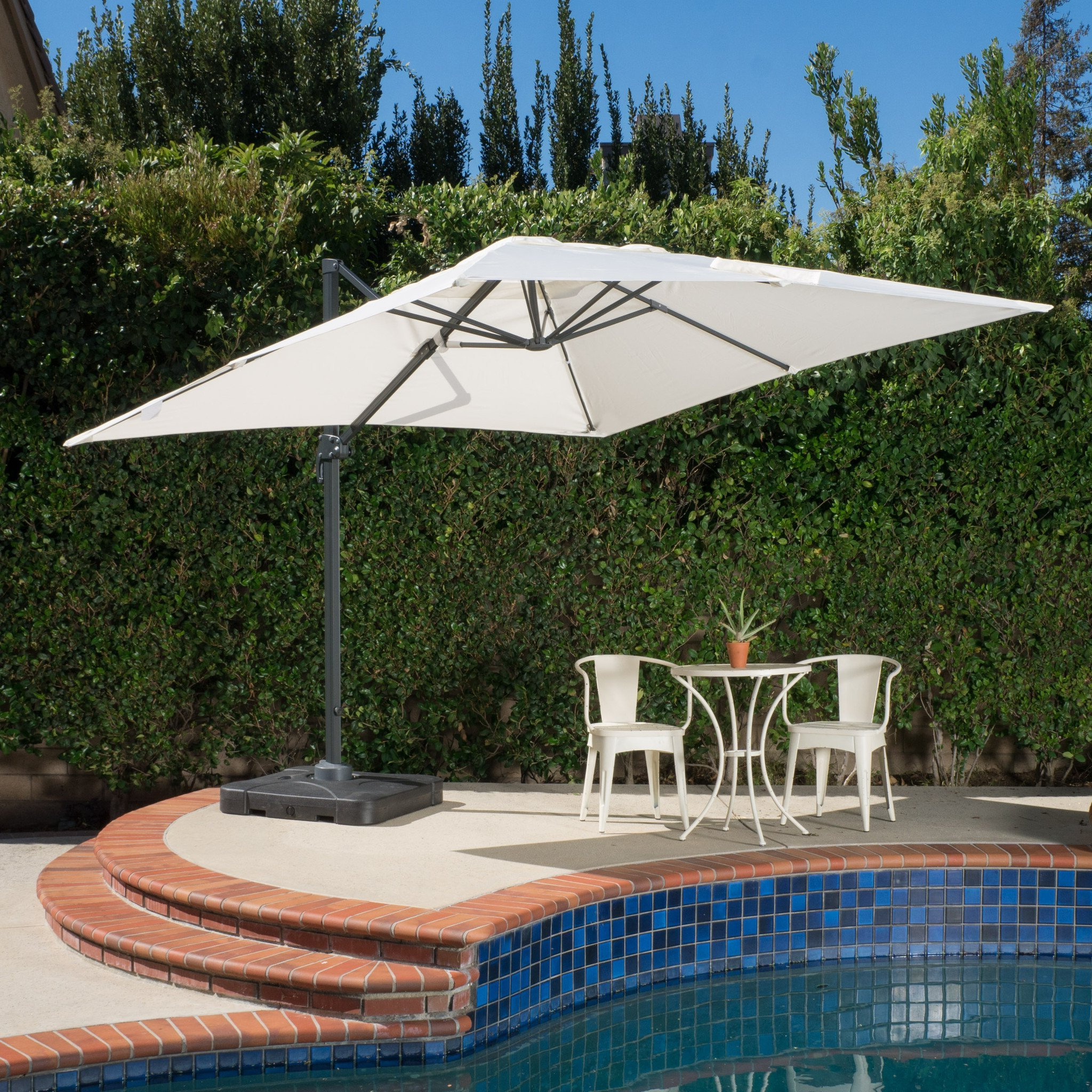 Well Liked Desmond Rectangular Cantilever Umbrellas Throughout Denise Austin Home Sardinia Outdoor 9'8 Foot Canopy Umbrella With Stand (View 13 of 20)
