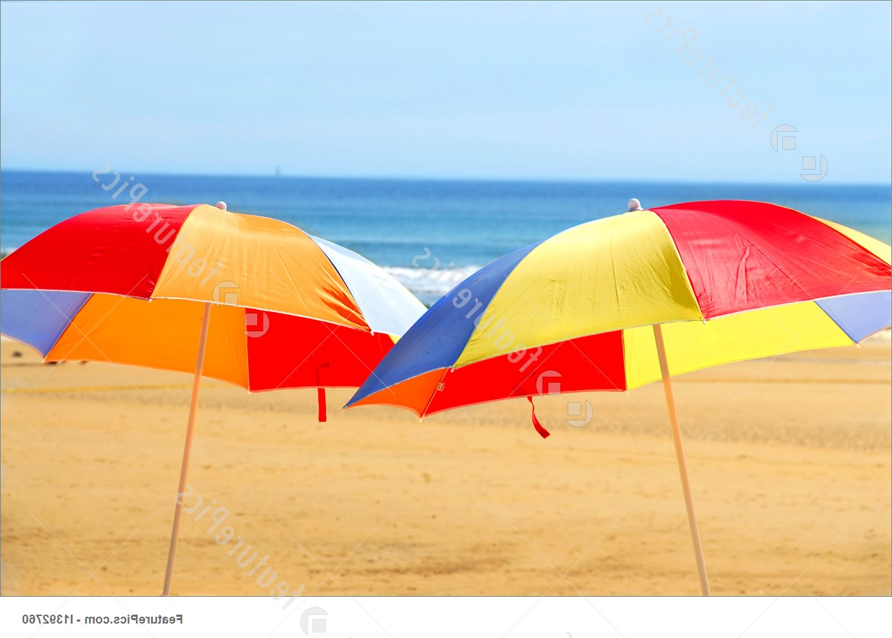 Widely Used Beach Umbrellas Throughout Two Beach Umbrella Standing On Ocean Shore (View 14 of 20)