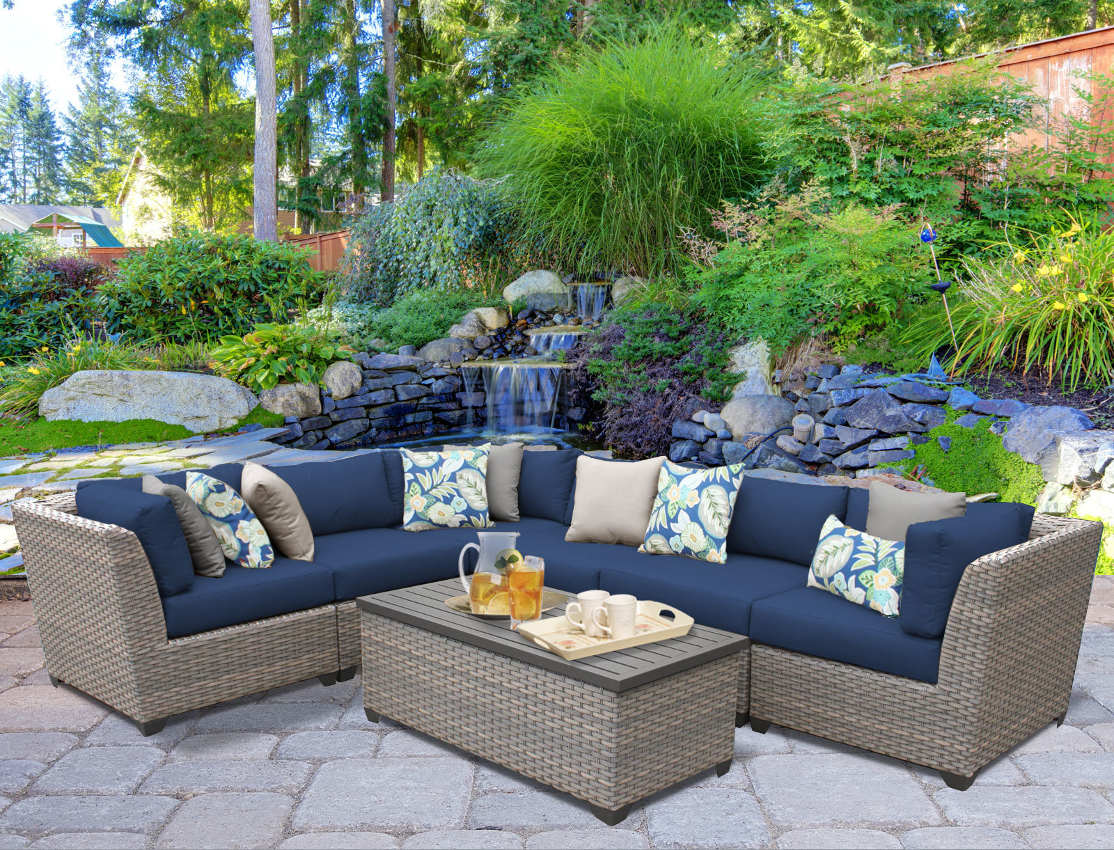 2020 Meeks 7 Piece Rattan Sectional Seating Group With Cushions Within Meeks Patio Sofas With Cushions (View 4 of 20)