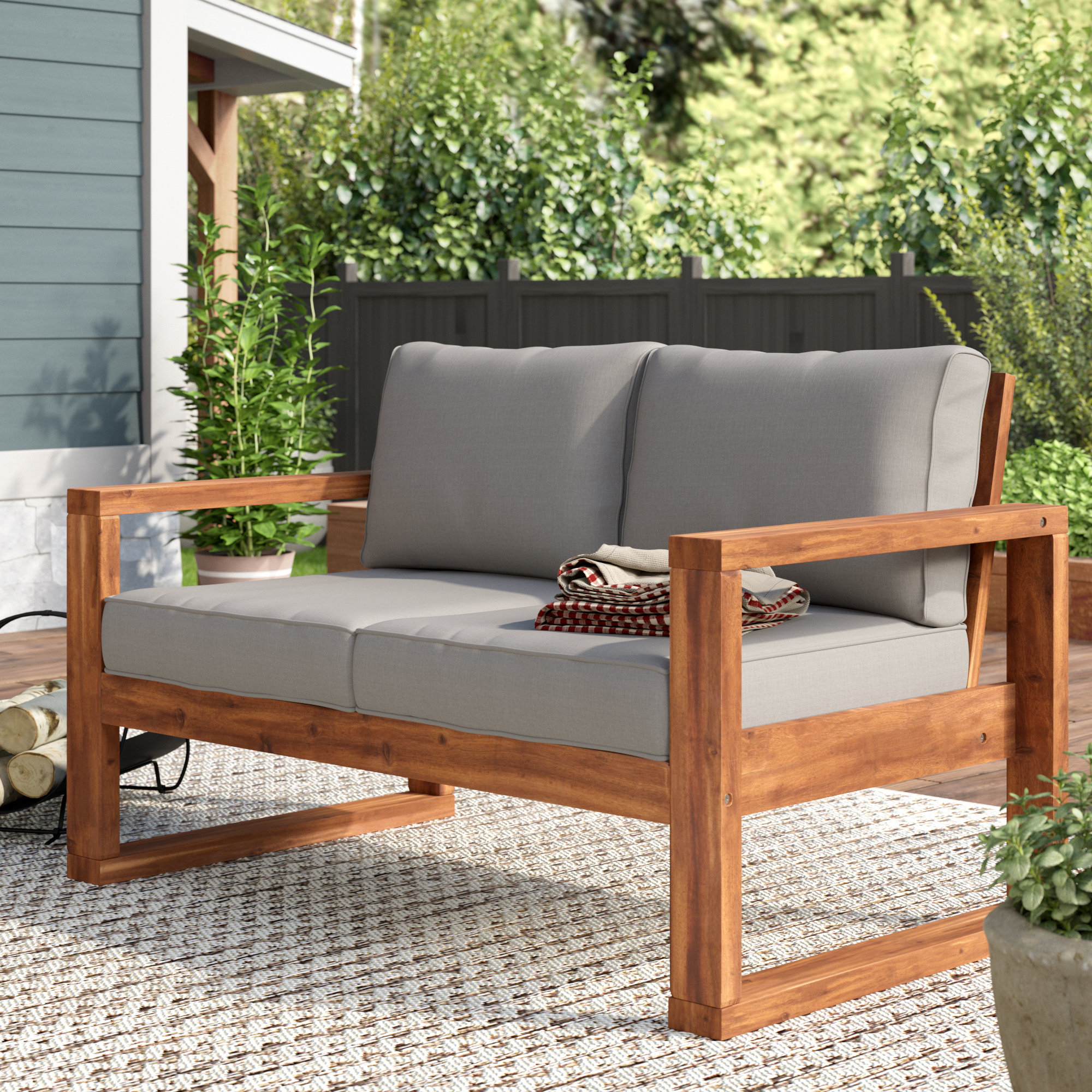 Fashionable Lyall Loveseat With Cushion Intended For Montford Teak Loveseats With Cushions (View 10 of 20)