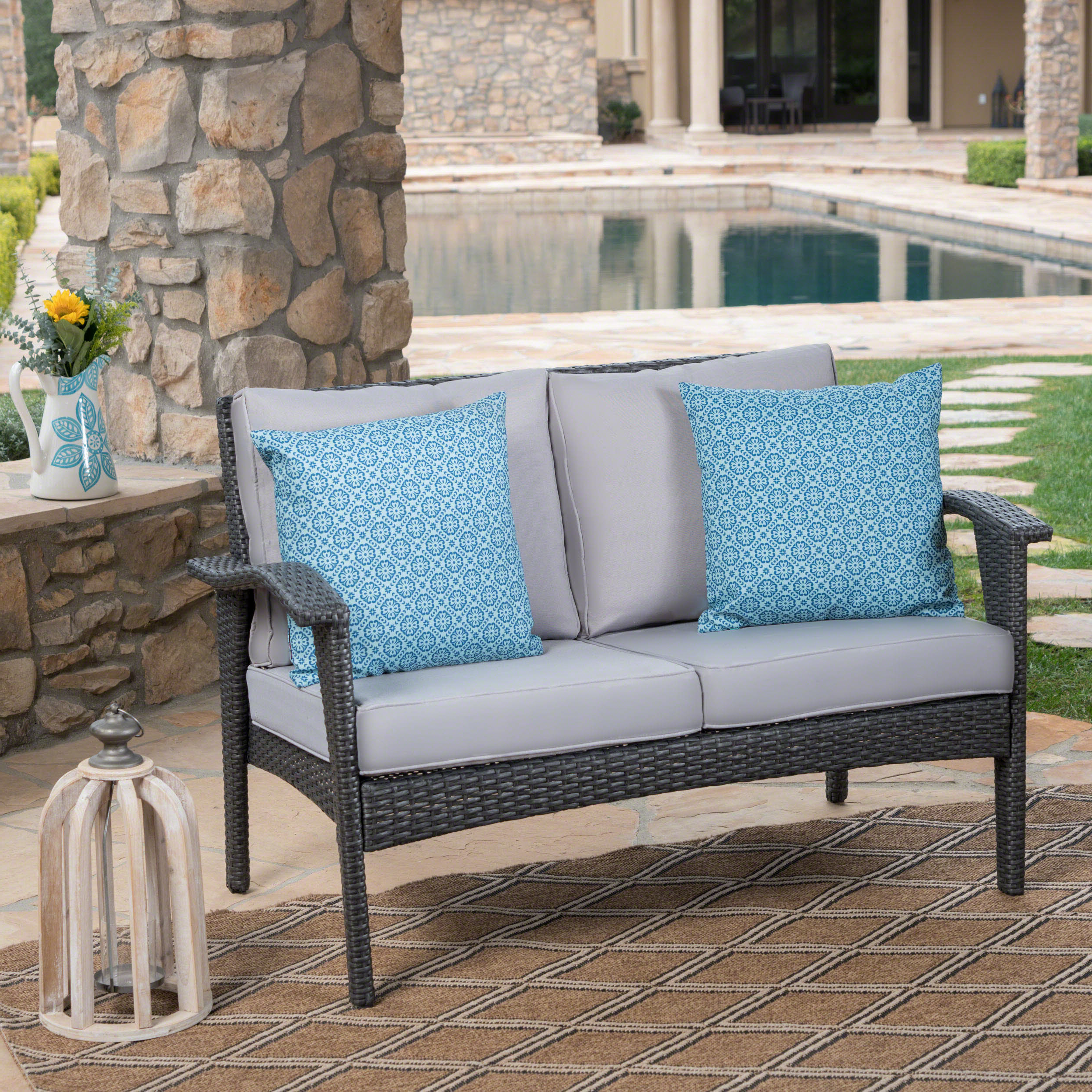 Karan Wicker Patio Loveseats Within Favorite Hagler Outdoor Loveseat With Cushions (View 10 of 20)