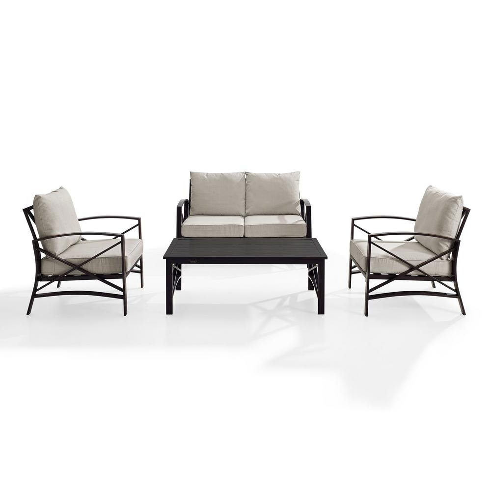 Chaise Lounge Chairs In Bronze With Oatmeal Cushions Throughout Most Recent Crosley Kaplan 4 Piece Metal Patio Outdoor Seating Set With Oatmeal Cushion – Loveseat, 2 Chairs, Coffee Table (View 10 of 25)