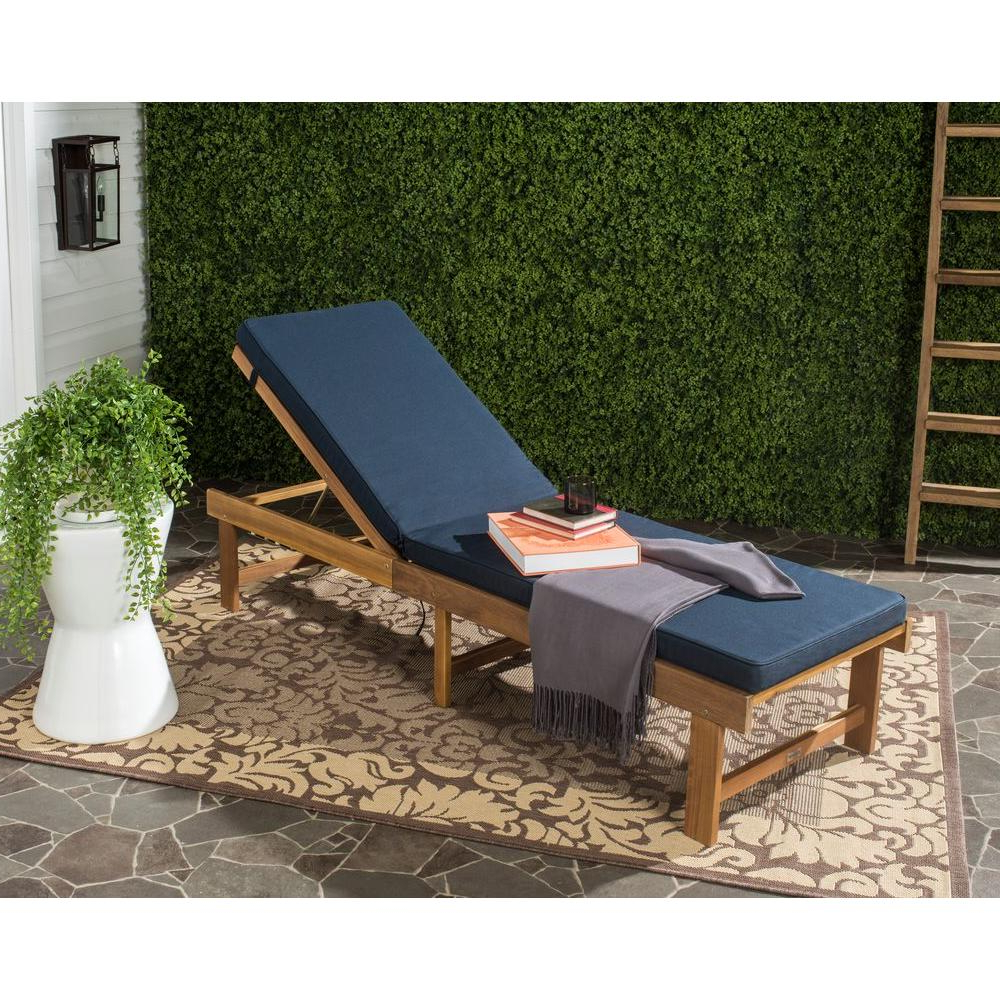 Most Popular Safavieh Inglewood Teak Brown/navy 1 Piece All Weather Wicker Outdoor  Chaise Lounge Chair With Navy Cushion Pertaining To Outdoor Rustic Acacia Wood Chaise Lounges With Wicker Seats (View 12 of 25)